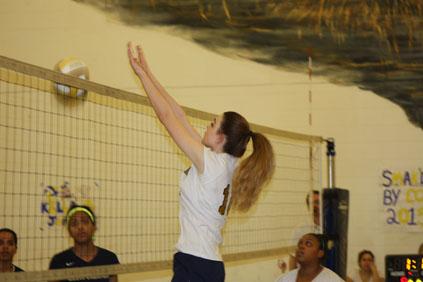 Junior, Victoria Tortora hitting the ball over the net.