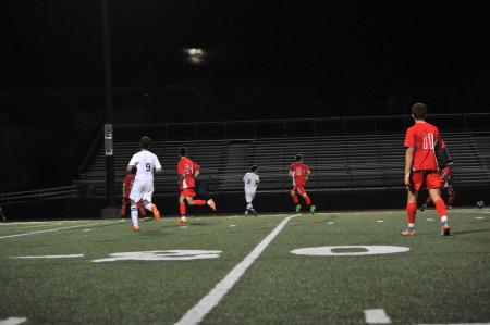 The Malden boys soccer team running upfield. Photo by Ana Kerr.