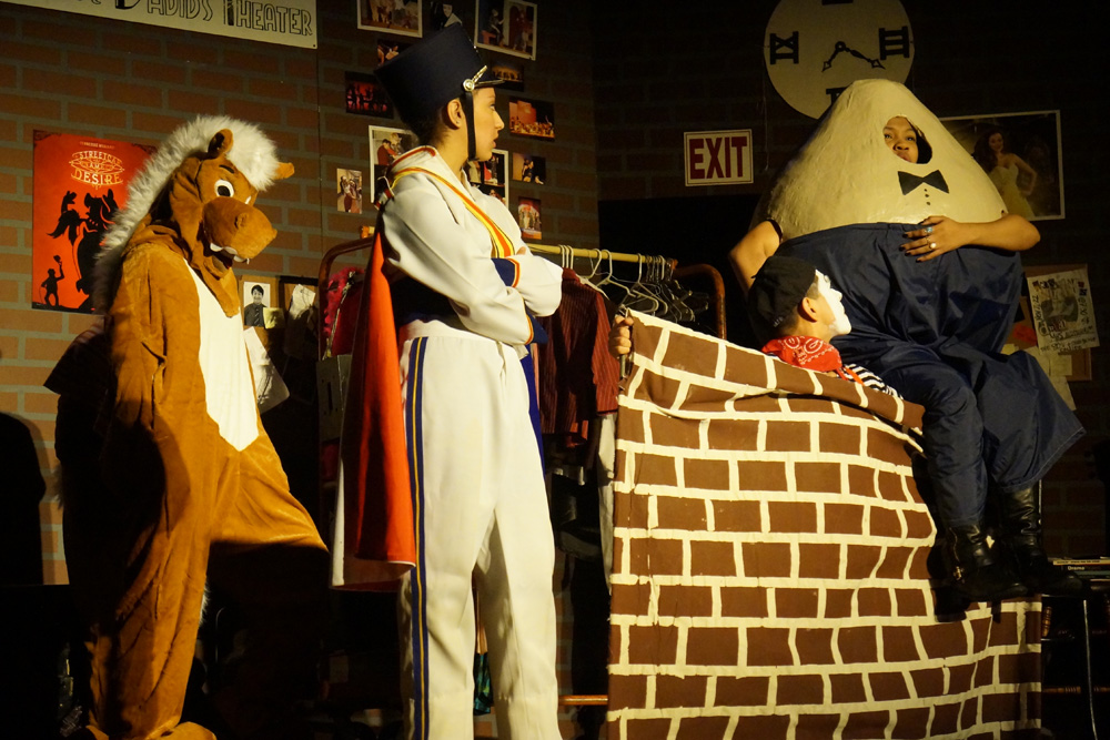 The cast acting out a scene from Humpty Dumpty. Photo by Meghan Yip.