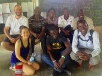 French teacher and Haitian Club advisor Paul Degenkolb with members of the Metanwa School in Haiti.
