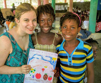 ESL teacher Jessica Haralson with students at the Matènwa Community Learning Center in Haiti. Photo submitted by Paul Degenkolb.