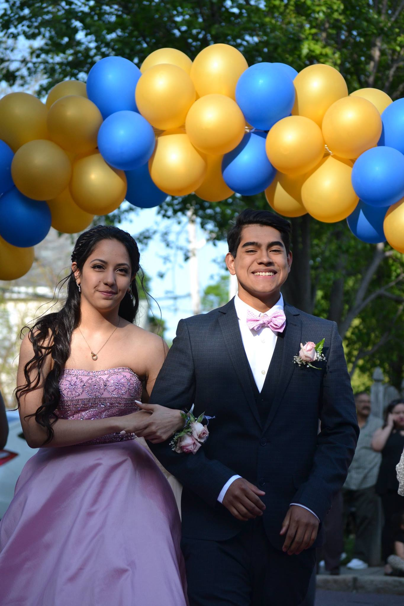 Seniors Kamila Regalado and Brayan Angula walking down the red carpet. Photo taken by Jesaias Benitez.