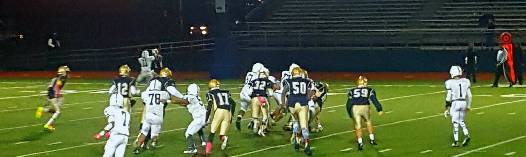Malden High School defense going after the ball carrier. Photo by Tenzin Dorjee.