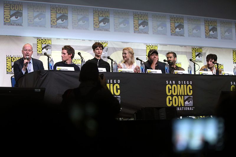 "David Yates, Eddie Redmayne, Katherine Waterston, Alison Sudol, Dan Fogler, Colin Farrell and Ezra Miller speaking at the 2016 San Diego Comic Con International, for ""Fantastic Beasts and Where to Find Them"", at the San Diego Convention Center in San Diego, California. Photo from Wikimedia."