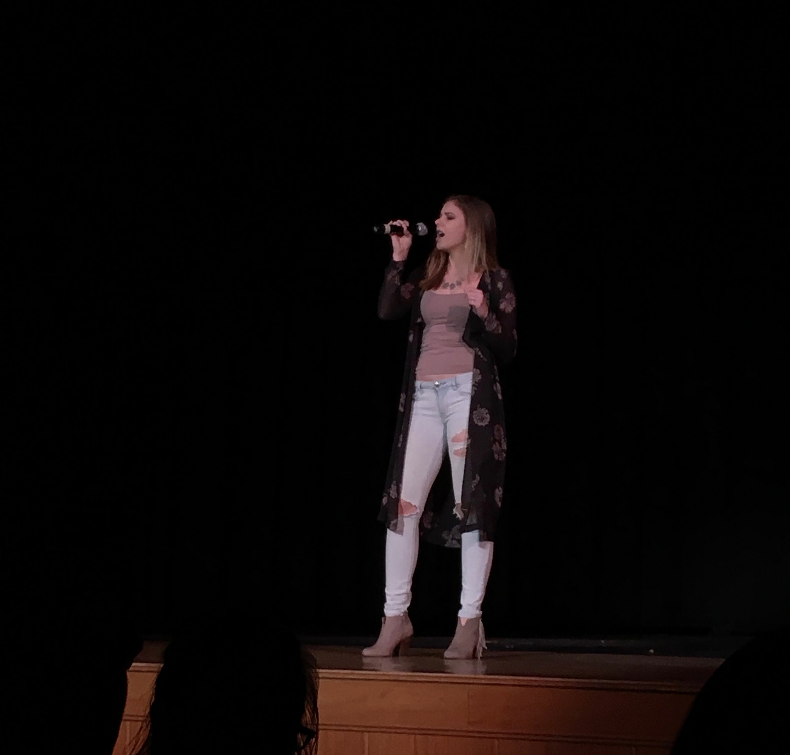 "Senior Caitlyn Leonard singing ""She Used to Be Mine"" by Sara Bareilles."