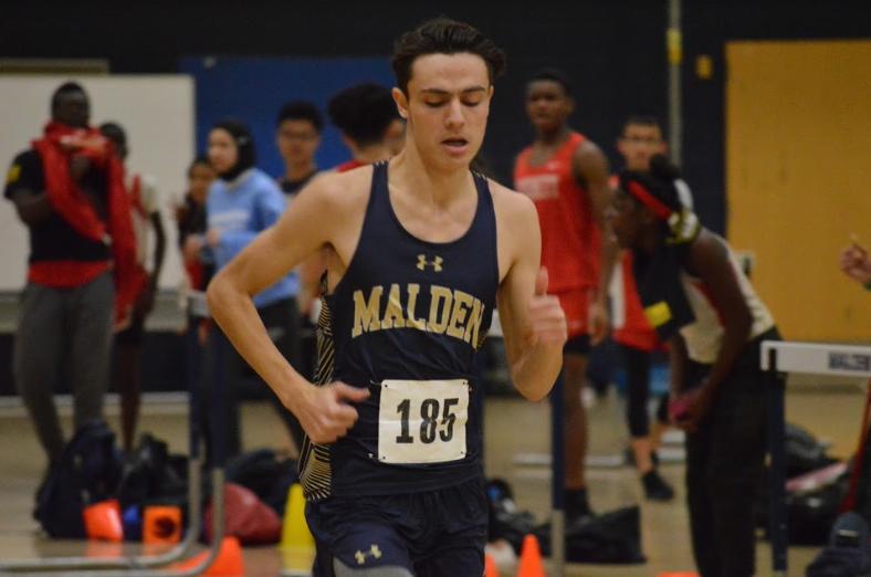 Junior Brendan Santos running. Photo by David Cartledge