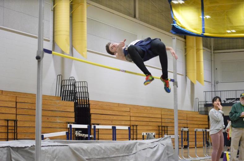 Senior Ezra Kruckenberg competing in the high jump. Photo by David Cartledge