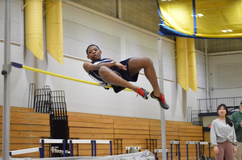 Sophomore Jelani Garrett competing in the high jump. Photo by David Cartledge